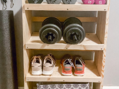 Fitness shelf with shoes, weights and a basket.