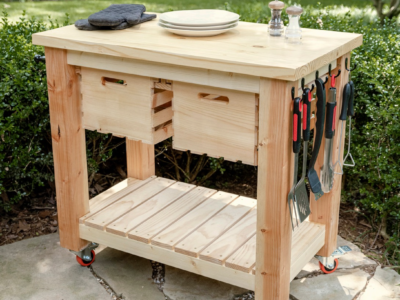 Wood grill cart on a patio