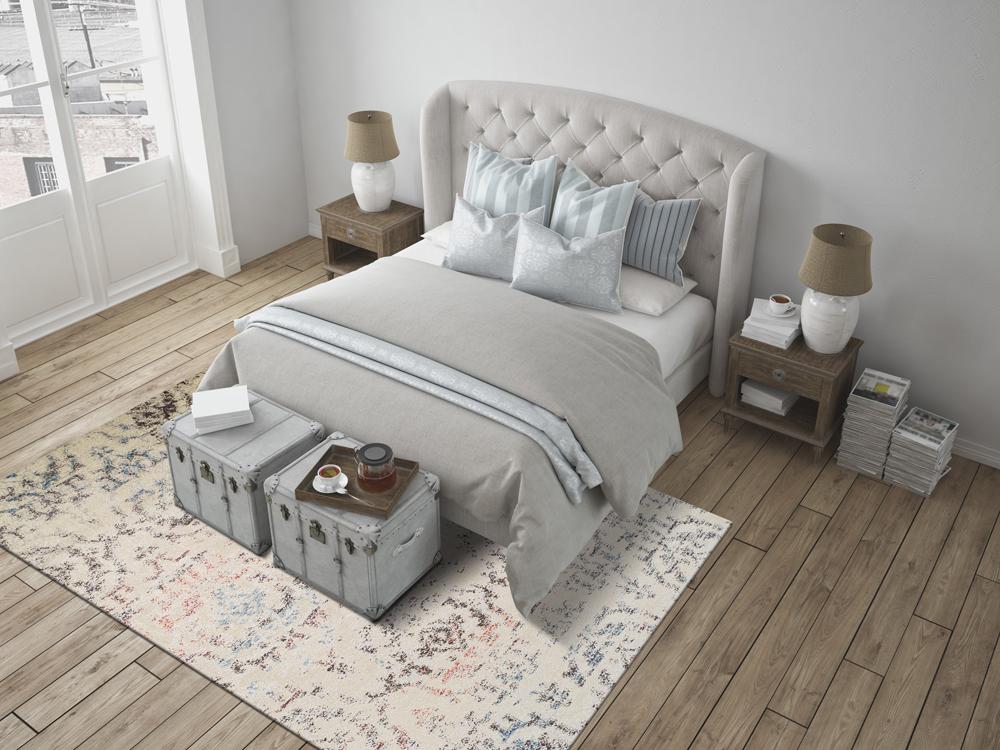 Area rug on hardwood floor in a bedroom