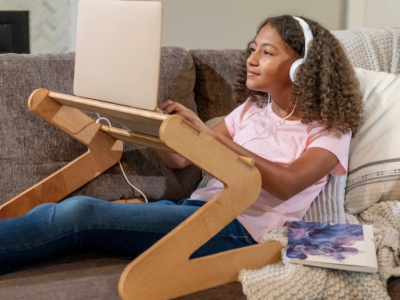 Teenager using a laptop stand
