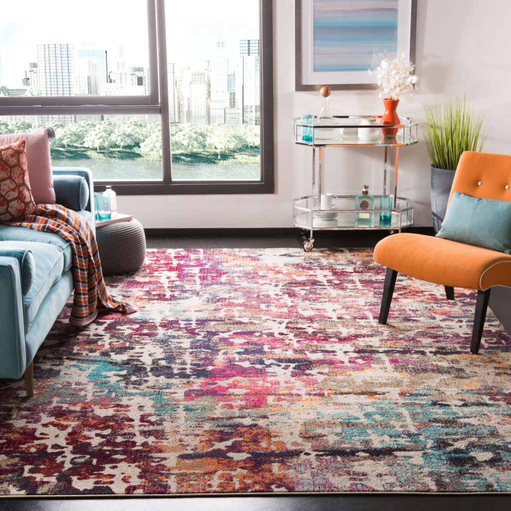 Colorful area rug in a bedroom