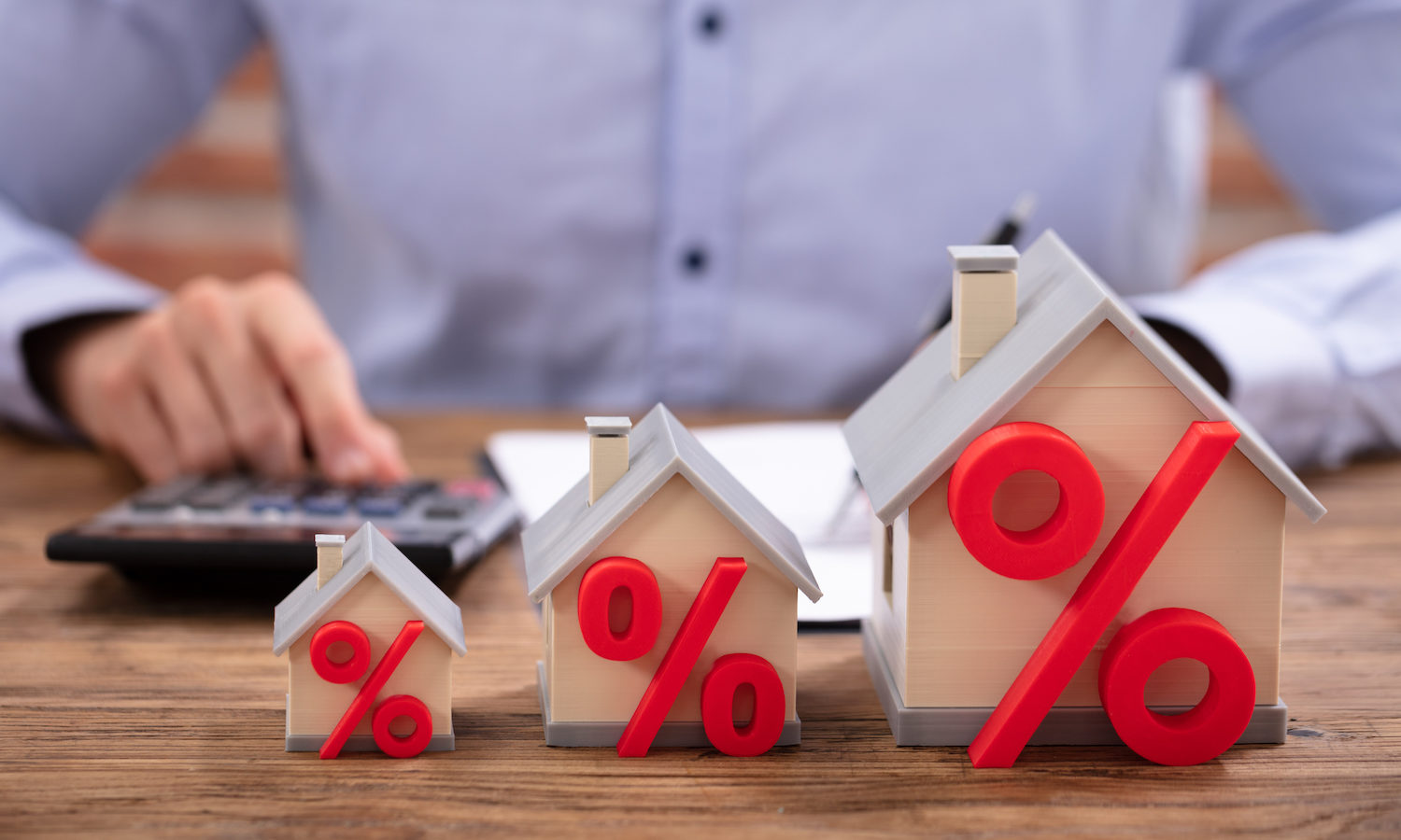 Model house showing increasing commission costs