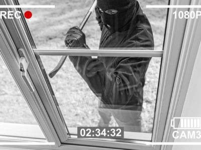 Burglar trying to break in to a home