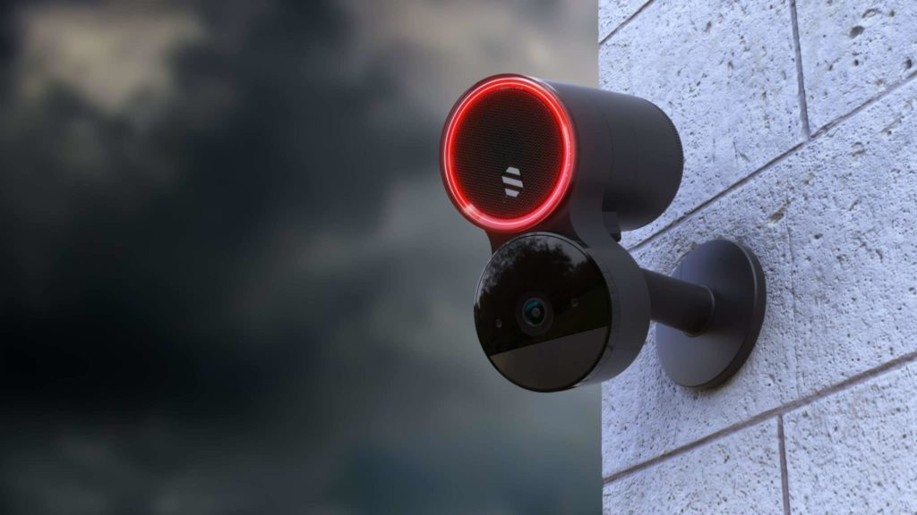 Security camera on an exterior wall.