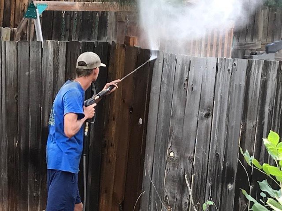 Pressure washing the fence