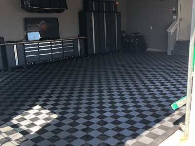 checkered vented grid-loc garage floor tiles.