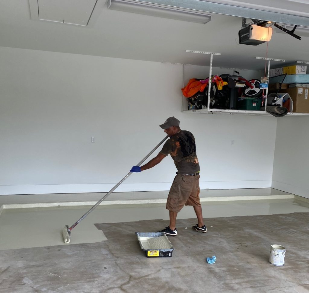 Garage floor being painted using DaiHard®100epoxy coating