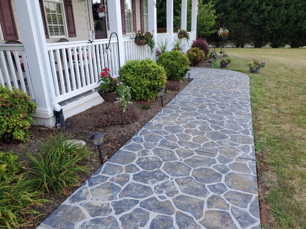 This front walkway was finished using SpreadStone™Decorative Concrete Resurfacing Kit and a Flagstone Stencil Kit from Daich Coatings.