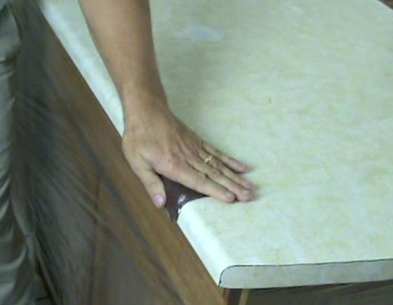 Sand laminate countertop before applying SpreadStone