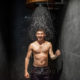 Man with bucket of ice cold water after hot sauna