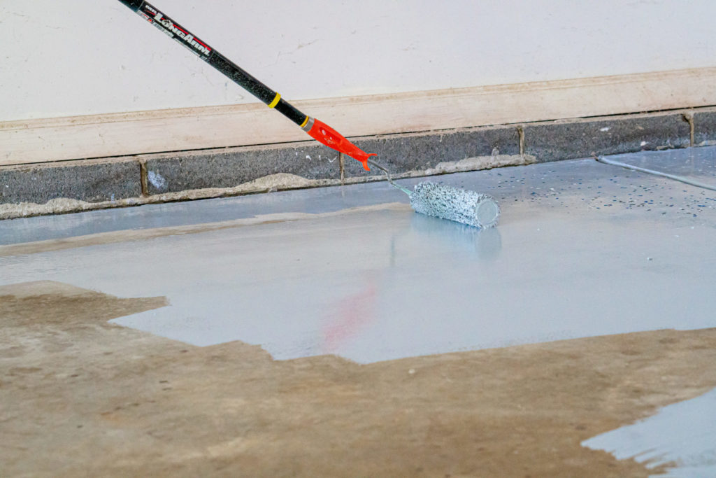 Applying garage floor epoxy coating